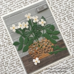 Copper Pot of White  Flowers Against a Brick Wall
