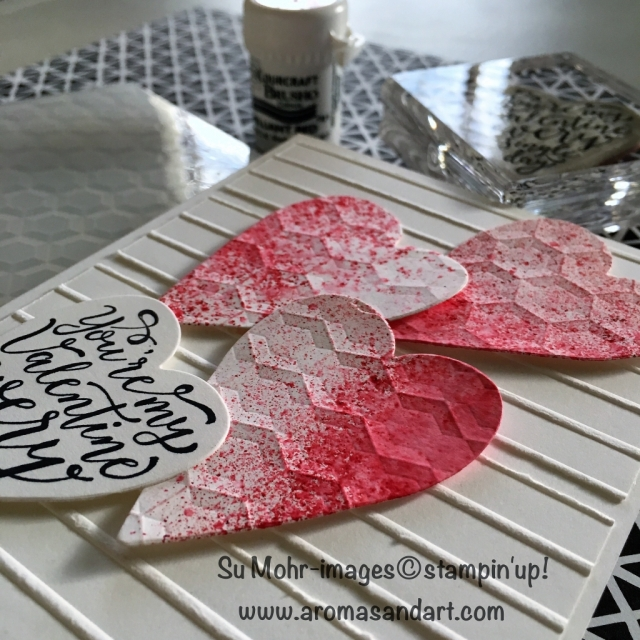 By Su Mohr; Click visit to go to my blog for details! Featuring: Brusho, Simple Stripes embossing folder, Hexagon embossing folder, Lots to Love Box Framelits, Sure Do Love You stamp set; #valentinecards #stampinup #suredoloveyou #brusho