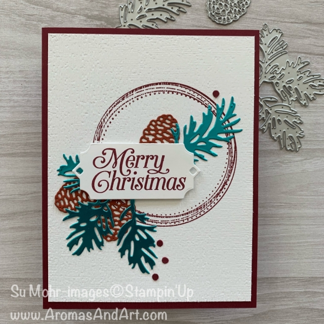 By Su mohr for Paper Players Design Team and Freshly Made Sketches; Click READ or VISIT to go to my blog for details! Featuring: Beautiful Boughs dies, Subtle Textured embossing, Swirly Frames stamp set, Noble Peacock Foil; #christmascards #holiday2019 #cardchallenges #colorcombinations #beautifulboughs #pinecones #handmadecards #handcrafted #diy #cardmaking